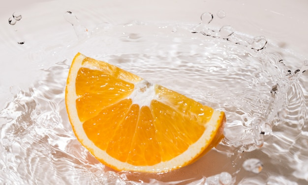 Slice of an orange in water Free Photo