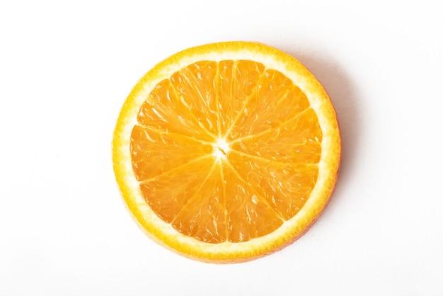 Slice ripe orange citrus fruit isolated on white. Free Photo