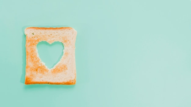 Slice of toasted bread with heart shape Free Photo