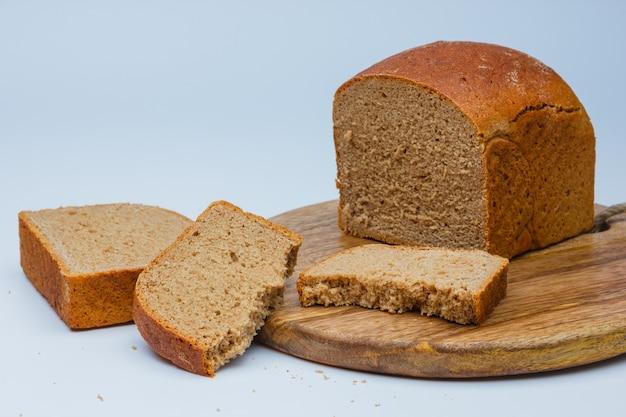 Sliced bread on cutting board Free Photo