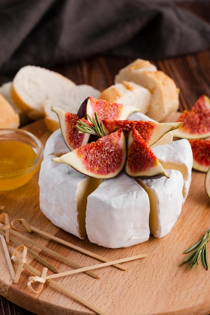 Sliced camembert roll with fig Free Photo