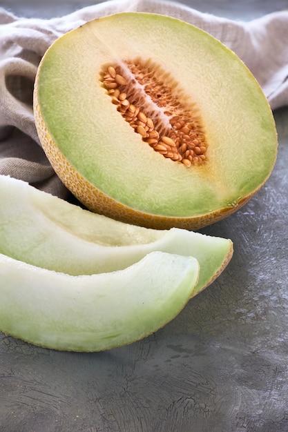 Sliced cantaloupe melone on dark Premium Photo