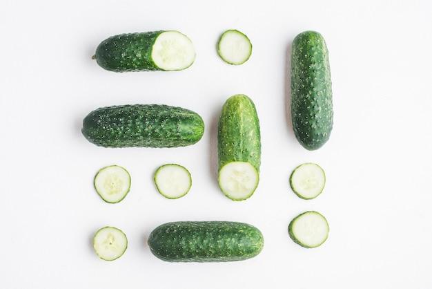 Sliced cucumbers on white background Free Photo
