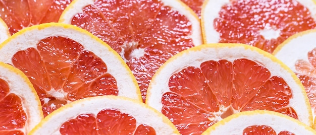 Sliced grapefruit as a background Premium Photo
