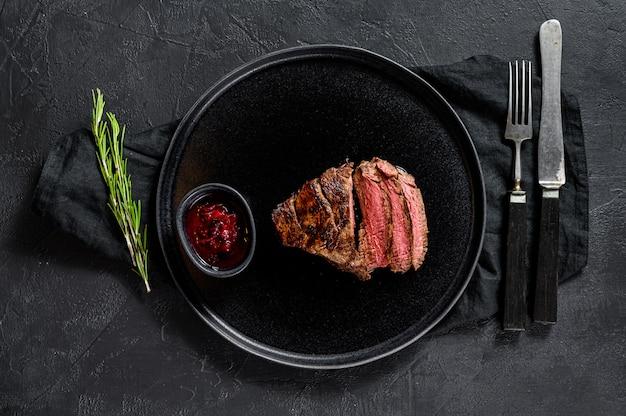 Sliced grilled filet mignon steak. beef tenderloin. Premium Photo