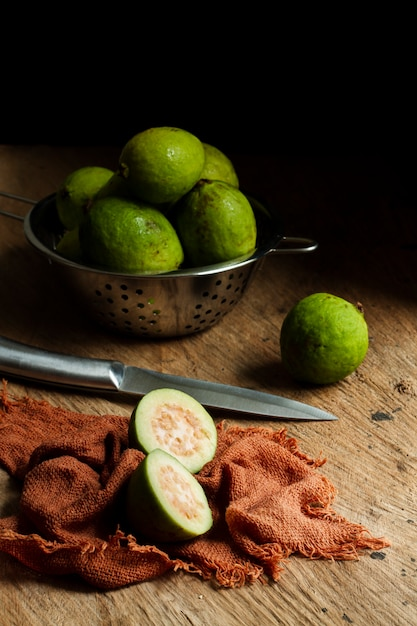 Sliced guava fruit on wooden table Free Photo