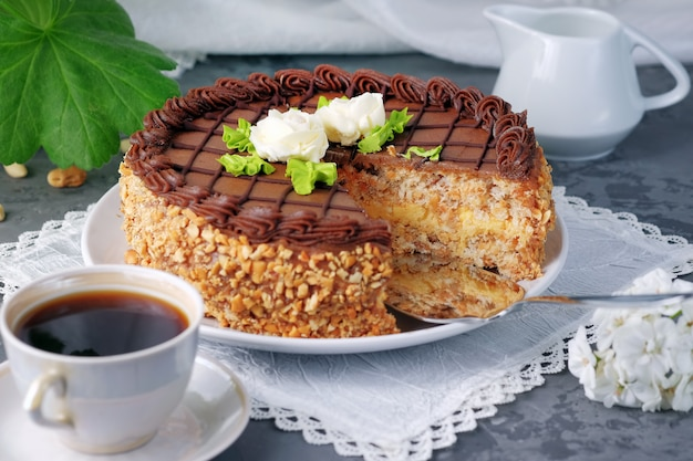 Sliced homemade kiev cake on the plate and cup of black coffee. Premium Photo