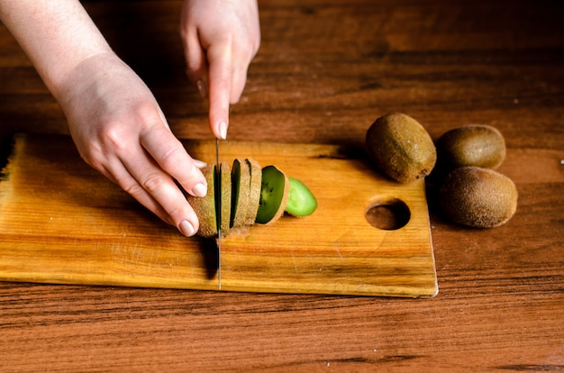Sliced kiwi on a wooden board. Premium Photo