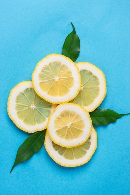Sliced lemon on blue background Premium Photo