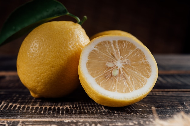 Sliced lemons on wood table Free Photo
