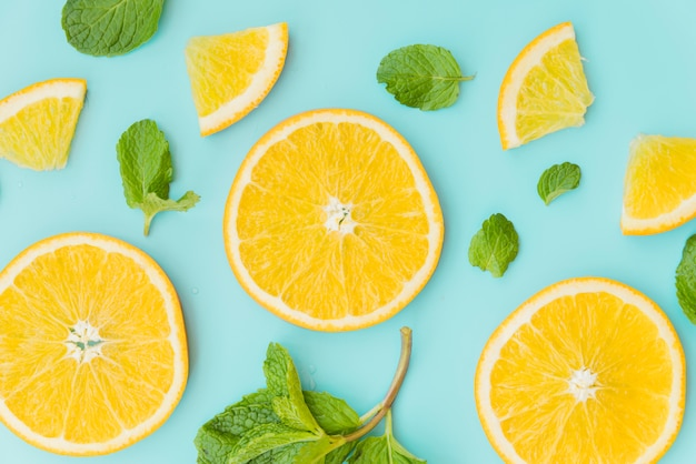Sliced orange and mint leaves pattern Free Photo