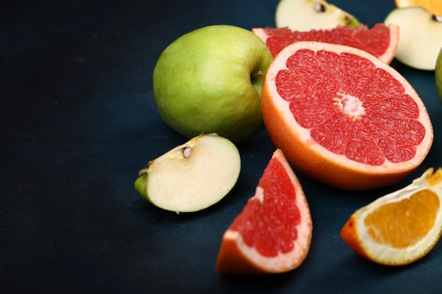 Sliced oranges, grapefruit and green apples. Free Photo