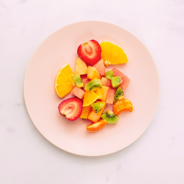 Sliced ripe exotic fruits on plate Free Photo