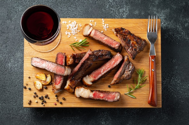 Sliced steak striploin. Premium Photo