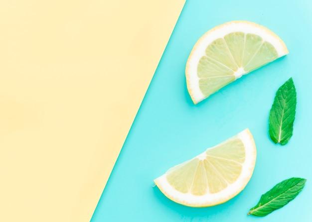 Sliced tasty sour lemon and green leaves Free Photo