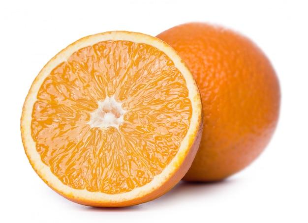 Sliced and whole oranges Free Photo