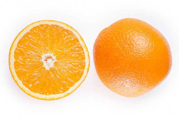 Sliced and whole oranges Free Photo