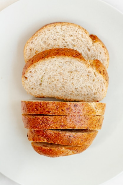 Slices of bread on white plate top view Free Photo