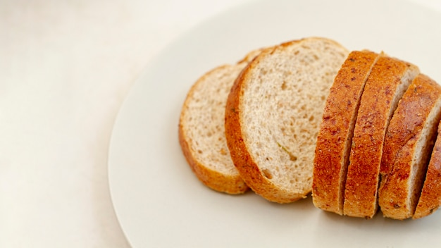 Slices of bread on white plate Free Photo