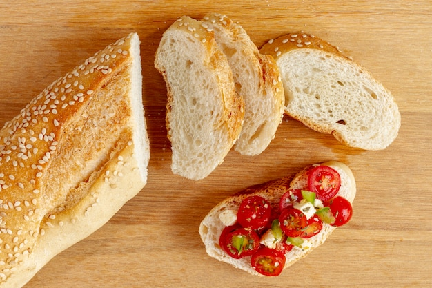 Slices of bread with cut tomatoes Free Photo