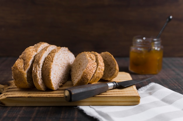 Slices of bread on wooden board with honey Free Photo