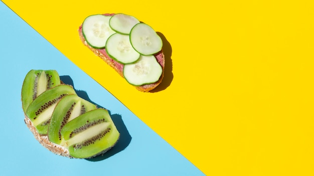 Slices of cucumber and kiwi on organic bread Free Photo