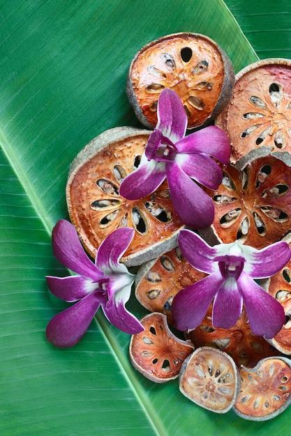 Slices of dry bael fruit on banana leaf. Premium Photo