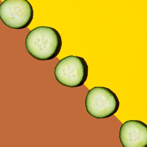 Slices of fresh cucumber arrangement top view Free Photo