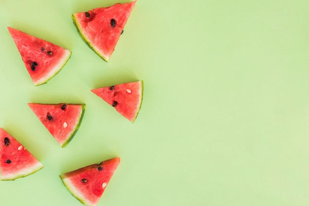 Slices of fresh red fruits Free Photo