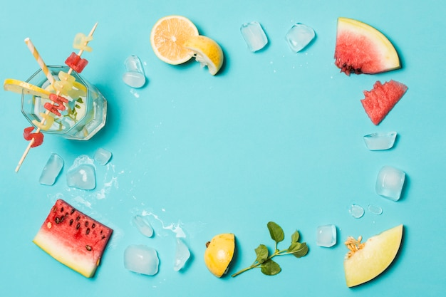 Slices of fruits between ice and summer title on glass Free Photo