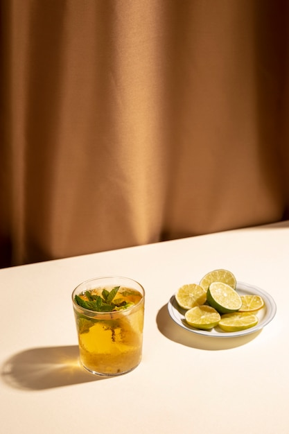 Slices of lemon with cocktail drink over white desk Free Photo