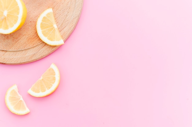 Slices of lemon on wooden board Free Photo