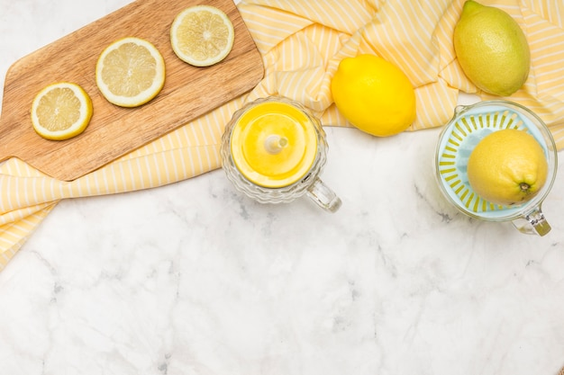Slices of lemons on marble surface Free Photo