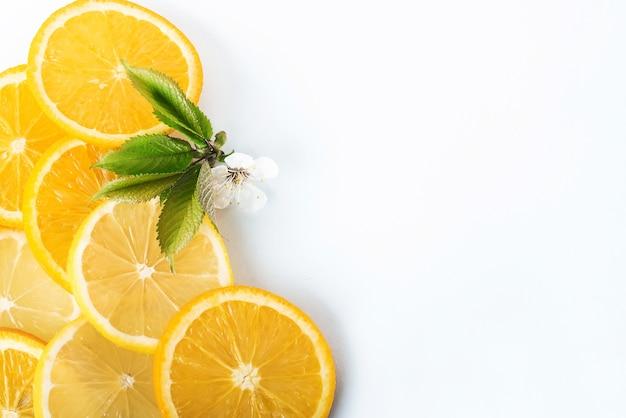 Slices of orange and lemon isolated on a white. Free Photo