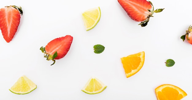Slices of strawberry and orange Free Photo