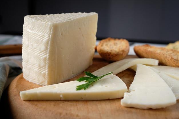 Slices of tender cow cheese Premium Photo