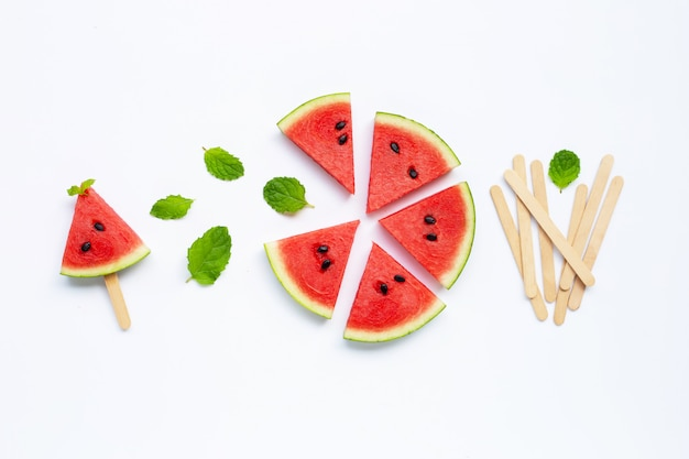 Slices of watermelon with popsicle on white Premium Photo