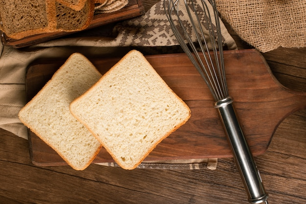 Slices of white bread on kitchen board Free Photo