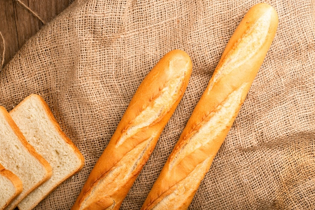 Slices of white bread with french baguette Free Photo