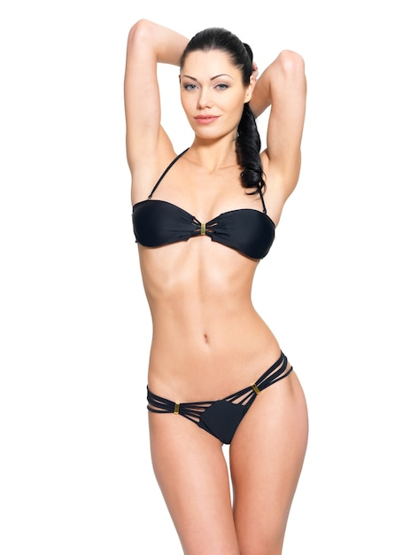Slim body of young woman in black bikini. Free Photo