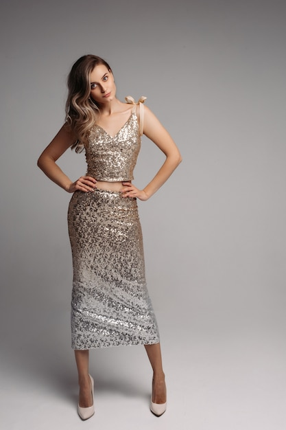 Slim model in sexy beige dress looking  and posing Premium Photo
