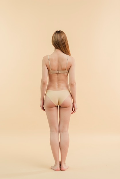 Slim redhead woman with long hair posing in underwear Free Photo