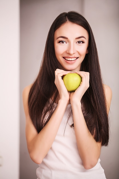 Slim woman hold in hand green apple Premium Photo