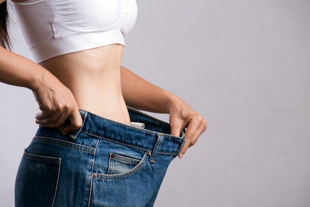 Slim woman in oversized blue jeans Premium Photo