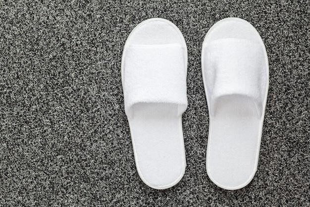 Slippers on the floor of hotel room Premium Photo