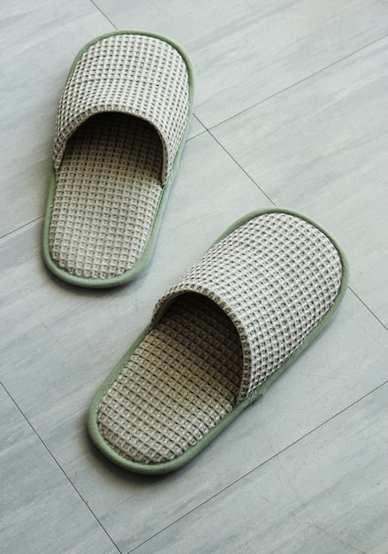 Slippers on the floor tile Free Photo