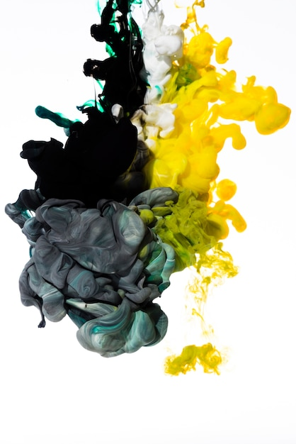 Slowly dissolving colored inks Free Photo