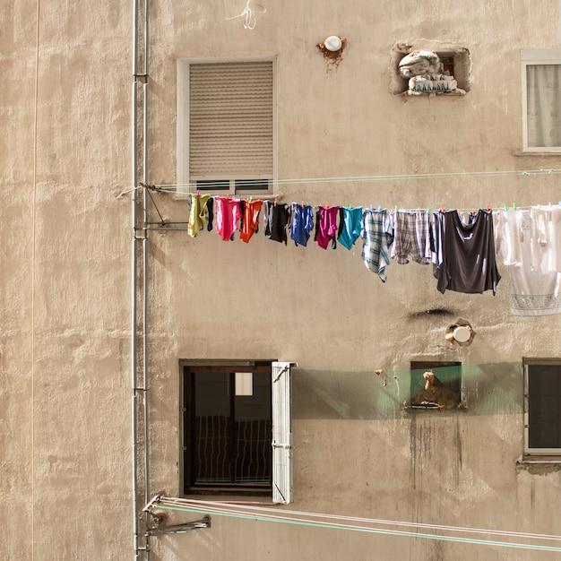 Slum neighborhood with cloths Premium Photo