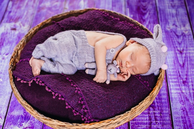 The small baby lies in the basket Free Photo