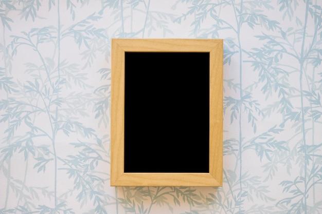 Small blackboard on wallpaper Free Photo